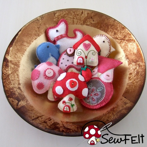 Small felt plush plushies stuffies hand sewn decorations in a bowl