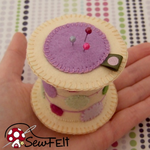 Sewing spool shaped pincushion made from felt handmade hand sewn item purple cream colors