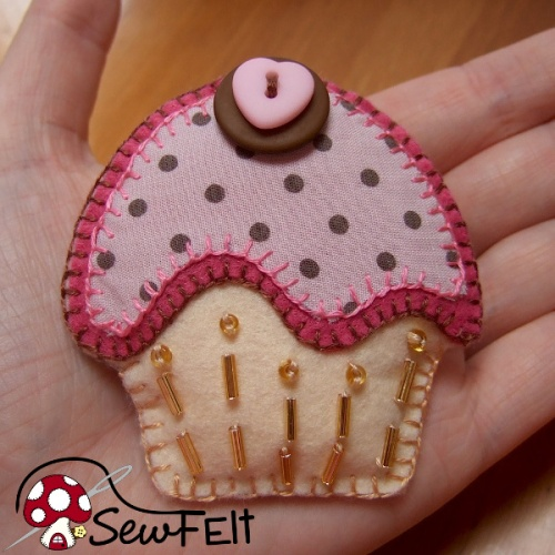 Pink and brown felt and fabric brooch with button and bead details