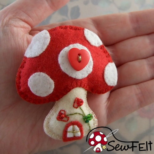 Red and white handmade hand sewn mushroom ornament decoration design with beads and button