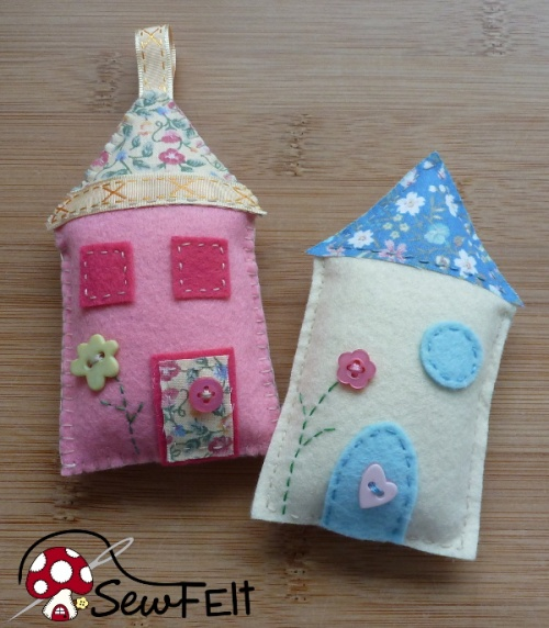 Hand sewn crafted houses from felt fabric pink and blue designs